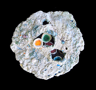 ceramic sculpture with spores and colored melted glass